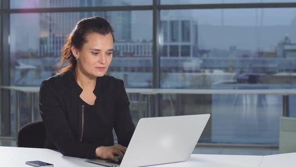 Positive Beautiful Woman Working Using Laptop at Modern Office
