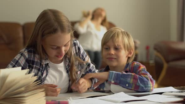 Thumbnail for Adorable Little Brother and Sister Studying at Home