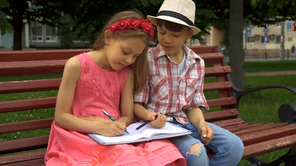 Thumbnail for Little Girl Draws on One Page of Notebook and Her Friend on Another