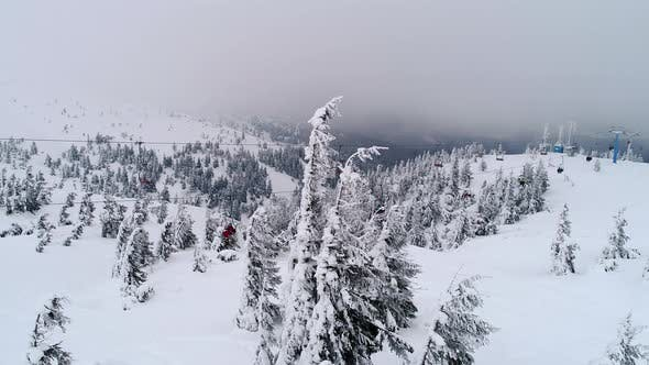 Thumbnail for Fly Over People on a Ski Lift