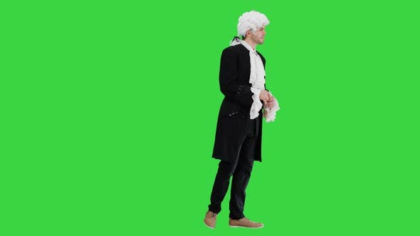 Man in 18Th Century Camisole and Wig Doing Welcoming Gesture on a Green Screen, Chroma Key.