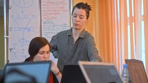 Woman Staff Worker Helps Intern Architect Coworker Gives Advice Tells Irrl. Information Feedback.