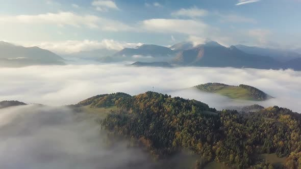 Cover Image for Morning Flight Above Foggy Clouds Forest Landscape in Autumn Nature Landscape