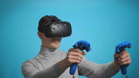 Thumbnail for Guy Plays with Modern Virtual Reality Headset