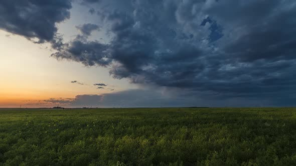 Thumbnail for Storm Clouds Rolling Over Prairies at Sunset  Time Lapse