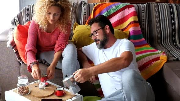 Thumbnail for Happy adult caucasian couple at home enjoy breakfast together
