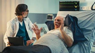 Elderly Patient Speaking with Doctor