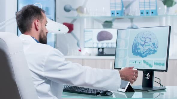 In Modern Research Facility Doctor Is Looking at X Ray Scans