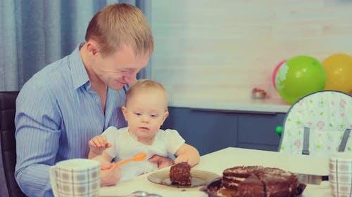 Dad Feeds Baby Cake