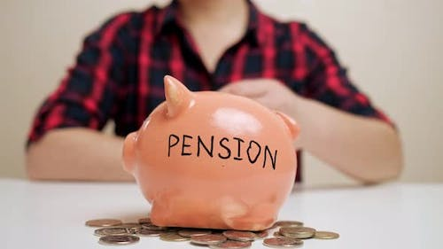 Lady Throws Coin Into Piggy Bank with Pension Inscription