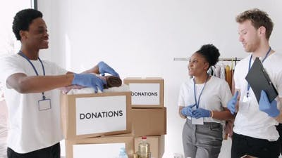 Diverse Charity Volunteers Sorting Through Donated Goods