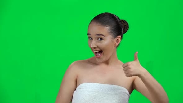 Thumbnail for Young Cheerful Woman Showing Thumbs Up, Gesture Like, Isolated on Green Screen at Studio