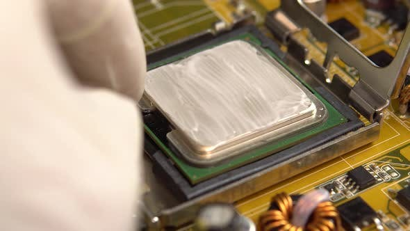 Inserts a Central Processor Onto the Motherboard. The Processing System of the Central Processes of