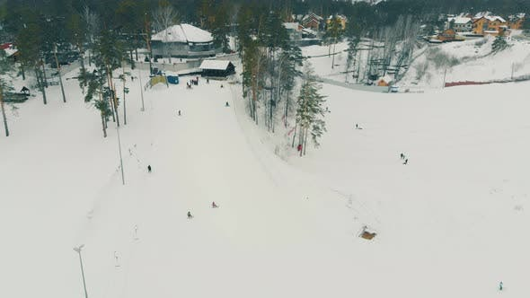 Thumbnail for People Ski and Snowboard on Huge Snowy Slopes with Rope Tow