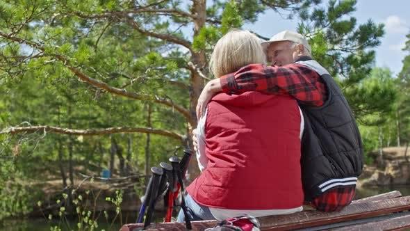 Thumbnail for Elderly Couple Hugging in Park