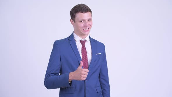 Thumbnail for Happy Young Handsome Businessman Giving Thumbs Up