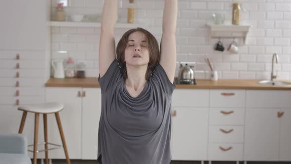 Young Woman Doing Final Stretch of her Online Fitness Training