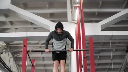 Male Push Up Workout on Crossbar in Gym Club