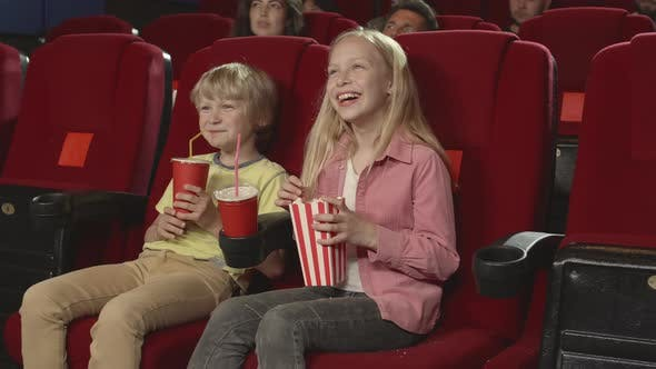 Thumbnail for Kids Watching Funny Cartoon in Cinema