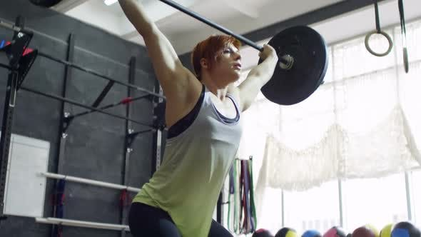 Thumbnail for Sportswoman Lifting Barbell Overhead