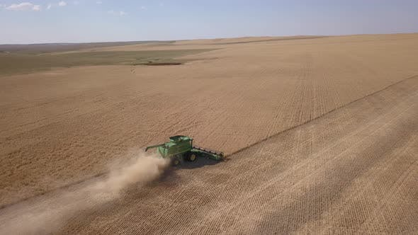Thumbnail for Great Plains Aerial in Summer Wheat Harvest Harvesting Combine Grain Crops