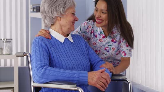 Thumbnail for Happy senior woman with friendly Mexican caregiver