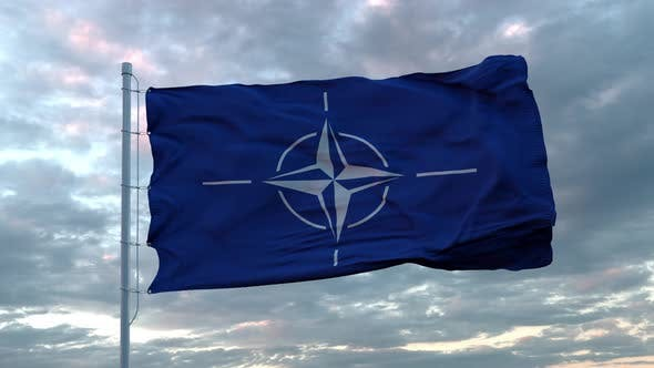 Realistic Flag of NATO in the Wind Against Deep Dramatic Sky