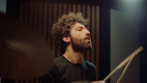 Musician Nodding Head in Studio. Drummer Making Rock Music in Concert Hall