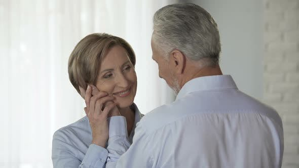 Thumbnail for Aged Male Cupping Woman Cheek Putting His Forehead Against Hers, Loving Feelings