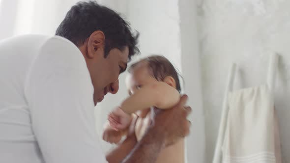 Thumbnail for Indian Father Playing with Little Daughter in Bathroom