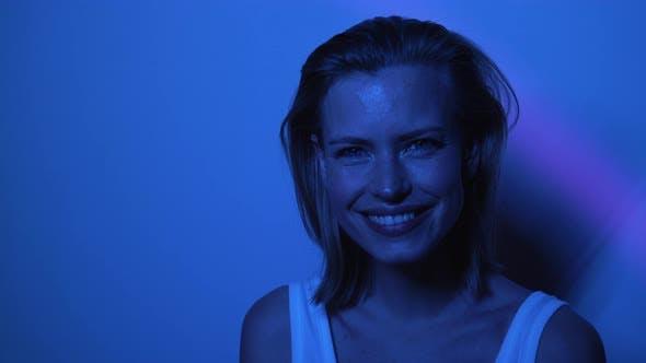 Beautiful Female Model in Dark Room Smiling