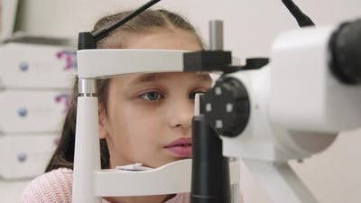 Little Girl At Oculist Office