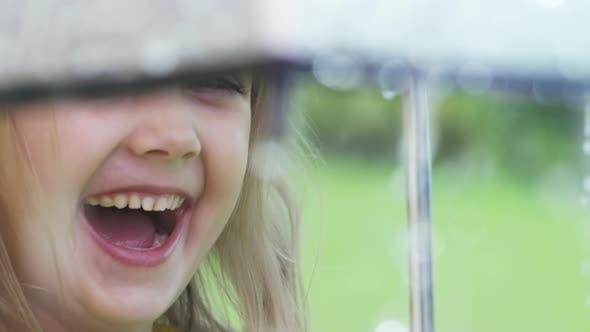 Thumbnail for Girl Laughing during Rain
