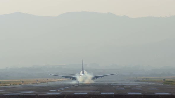 Airplane Landing At Airport Runway