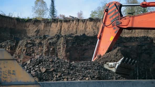 Thumbnail for A Bucket of Red Excavator Loads a Dump Truck