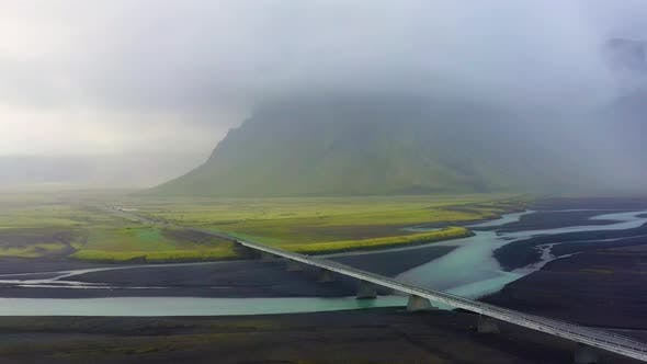 Cover Image for Iceland. Aerial View on The Mountain, Road and River.