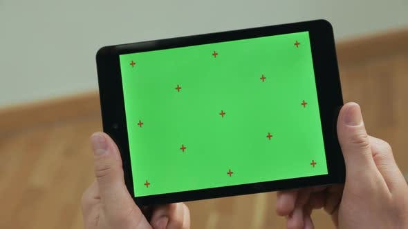 Male Hands Holding Tablet. Close Up Man Tapping Tablet Green Screen Tablet
