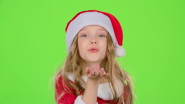 Thumbnail for Kid Girl in Red Christmas Caps Send Air Kisses. Green Screen