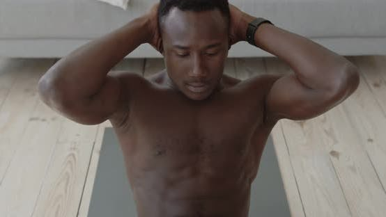 Thumbnail for Close Up Portrait of Young Muscular Black Man Practicing Criss Cross Crunches Exercise at Home