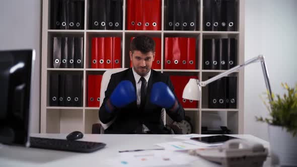 Thumbnail for Businessman Wearing Boxing Gloves in Office