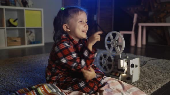 Thumbnail for Girl Child Watching Movie On Film Cinema Projector With Dog