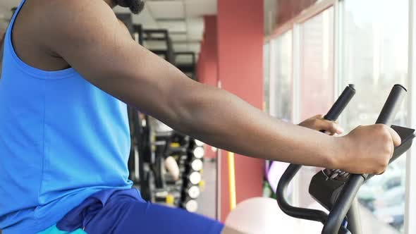Thumbnail for Athletic Male Riding a Stationary Bike in the Fitness Club, Sport and Health