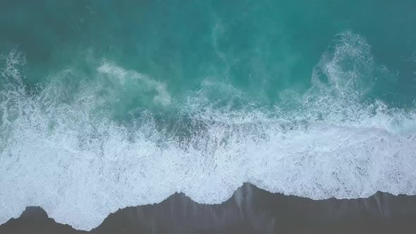 Thumbnail for Aerial Top Down View of Turquoise Sea Waves Foaming and Splashing, Big Waves From Above Rolling