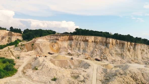 Large Industrial Sand Quarry. Equipment That Works in a Sand Quarry. The Mountain From Which Sand Is