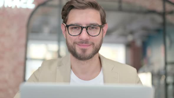 Man with Laptop Shaking Head As No Sign