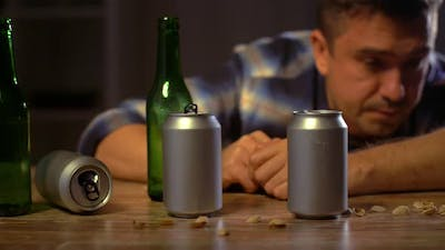 Drunk Male Alcoholic Drinking Beer at Home