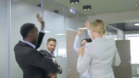 Thumbnail for Happy Business Team Celebrating Victory in Office