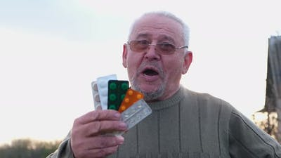 Grandfather with Pills in His Hands