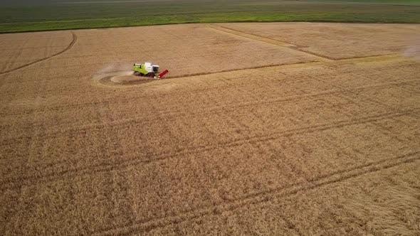 Thumbnail for Aerial View Harvester Turns Backward on Golden Field