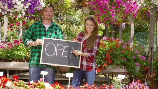 Thumbnail for Two Florists with Open Sign in Their Shop